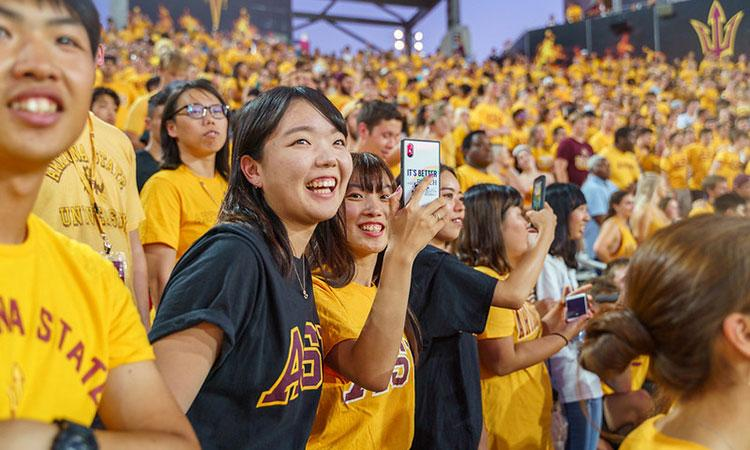 Two female students at a ASU sporting event